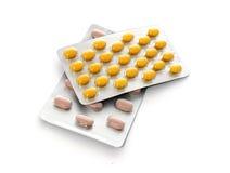 Tabletas para el tratamiento de la enfermedad aislado en blanco Imagen de archivo