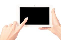 Tabletcomputer in een hand Stock Foto's