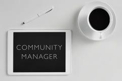 Tabletcomputer en tekst communautaire manager Royalty-vrije Stock Foto