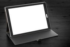 Tabletcomputer met het lege scherm en geval op de houten lijst, Stock Foto