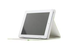 Tabletcomputer met tribune op een witte achtergrond Royalty-vrije Stock Afbeelding