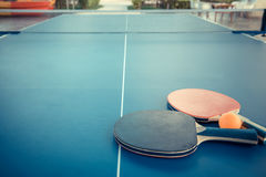 Tabletennis or ping pong rackets and balls on table. Sport conce Royalty Free Stock Images
