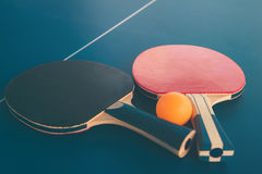 Tabletennis or ping pong rackets and balls on table. Sport conce Stock Photos