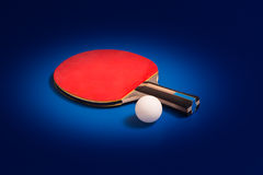 Tabletennis racket and ball Stock Photos