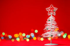 Tabletop Christmas tree on red background Royalty Free Stock Photos