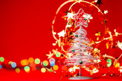 Tabletop Christmas tree with tinsel on red background Royalty Free Stock Images