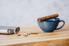 Tabletop with cigar and flask Stock Images