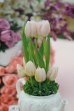 Tabletop decoration. S with tulips and roses stock images