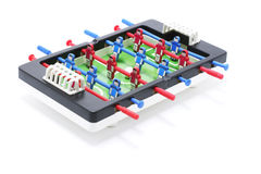 Tabletop Football Game. Drop out on white background royalty free stock image
