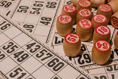 Tabletop old lotto game with wooden elements. Cards bingo Stock Photography