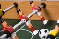 Tabletop soccer. Playing tabletop soccer with red and yellow figures Royalty Free Stock Image
