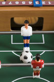 Tabletop soccer. Playing tabletop soccer with red and yellow figures Royalty Free Stock Photography