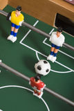 Tabletop soccer. Playing tabletop soccer with red and yellow figures Stock Images