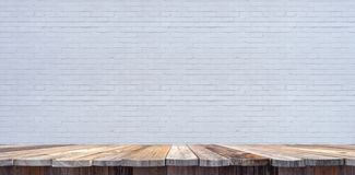 Tabletop template with old wooden planks and white brick wall in background stock photography