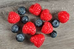 Tabletop view on couple of raspberries and blueberries mixed. Tabletop view on couple of raspberries and blueberries mixed Royalty Free Stock Photography