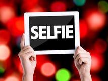 Tabletpc met tekst Selfie met bokehachtergrond Stock Foto