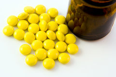Tablets. Yellow tablets on white background Royalty Free Stock Image