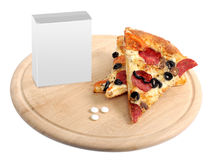 Tablets and appetizing pizza on a wooden splate Stock Photography
