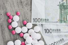 Tablets and banknotes Stock Images