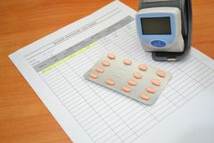 Tablets for blood pressure control and tonometer royalty free stock images