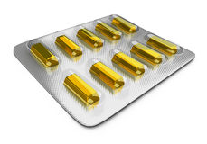 Tablets_bullion. Gold ingots in packing for tablets on the white isolated background Royalty Free Stock Images
