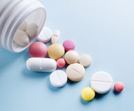 Tablets with capsules. Royalty Free Stock Image