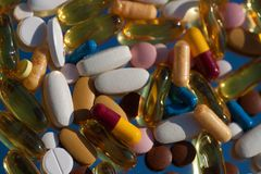 Pills and capsules placed on flour Royalty Free Stock Photo