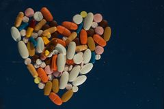 Pills placed in heart shape Stock Photo