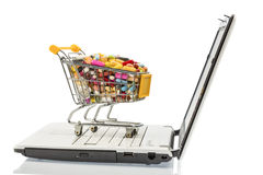 Tablets with cart and computer Royalty Free Stock Photo