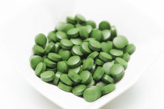 Tablets of Chlorella - green algae Stock Photos