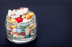 Tablets, coated tablets, pills in glass Royalty Free Stock Photography
