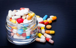 Tablets, coated tablets, pills in glass Stock Photos