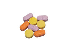 Tablets in color isolation on white. Tablets medicine in multiple colors, isolation on white Royalty Free Stock Images