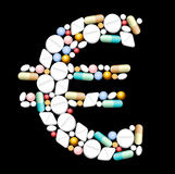 Tablets Euro. Tablets, pills and capsules, that shape an euro sign Royalty Free Stock Image