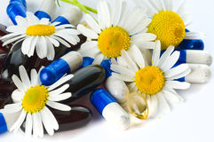 Tablets and flowers. Royalty Free Stock Image