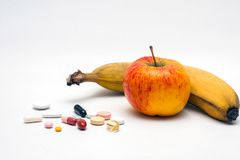 Tablets and fruits Stock Photos