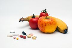 Tablets, fruits and vegetable Stock Images