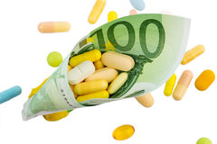 Tablets and hundred euro bill Stock Image