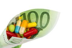 Tablets and hundred euro bill Royalty Free Stock Images