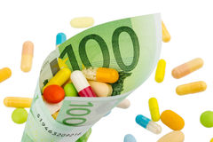 Tablets and hundred euro bill Stock Images