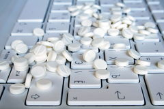Tablets on the keyboard Stock Images