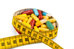 Tablets and measuring tape Royalty Free Stock Images