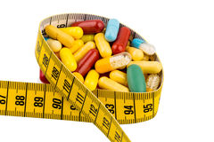 Tablets and measuring tape Stock Image