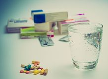 Tablets and medicines and a glass of water royalty free stock photo