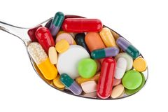 Tablets and medicines on spoon Stock Photography