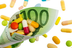 Tablets and one hundred euro bill Royalty Free Stock Photo