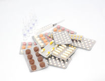 Tablets in packing. Capsule and medical syringe Royalty Free Stock Photography