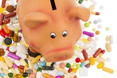 Tablets and piggy bank Stock Images