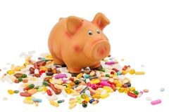 Tablets and piggy bank Stock Photo