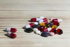 Tablets and pills different colors. The pills in the vial Stock Images